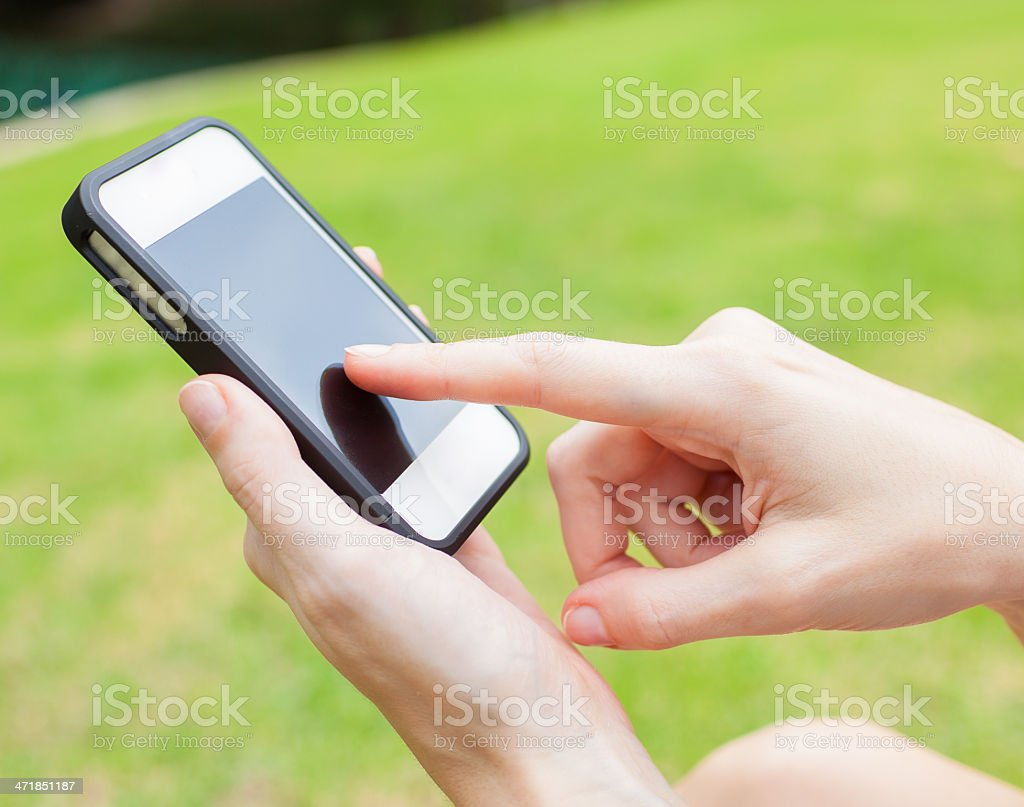 Female using mobile smart phone royalty-free stock photo