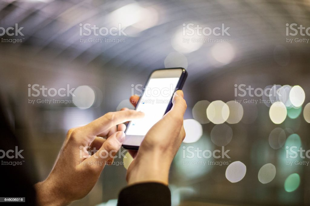 Female using smart phone stock photo