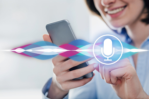 Female Using Virtual Assistant On Smart Phone Stock Photo ...