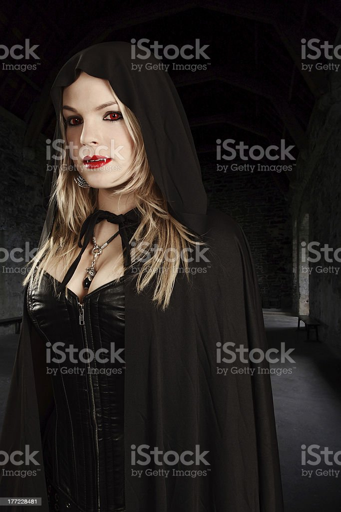 Female vampire in hooded cape royalty-free stock photo