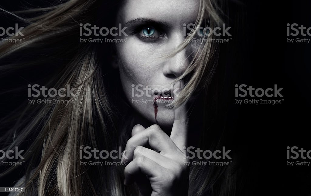 A female vampire with blood dripping royalty-free stock photo