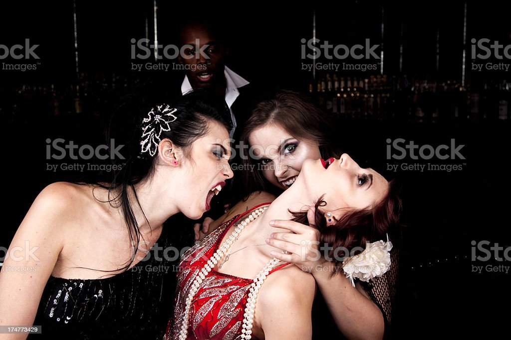 Female Vampires Attacking a Victim royalty-free stock photo