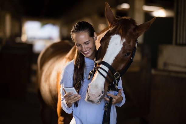 Female vet using mobile phone while standing by horse picture id838081922?b=1&k=6&m=838081922&s=612x612&w=0&h=p2a2t38yocrj3c0yc47e3mlgrqjljrvozuotyuxkivy=