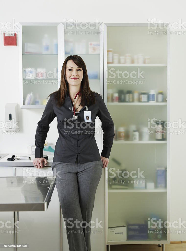 Female veterinarian in vet exam room, smiling, portrait royalty-free stock photo