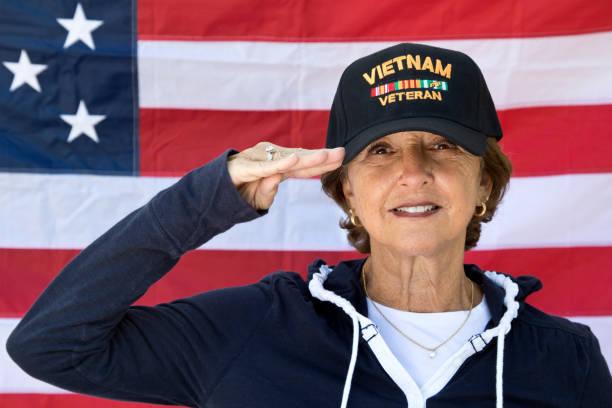 Female vietnam veteran saluting looking content wearing veterans cap picture id858733456?b=1&k=6&m=858733456&s=612x612&w=0&h=dlyame0x74wkfqeu3t3n920jzhxm9wgfbe9vuwbynw4=