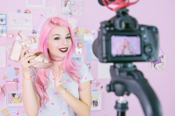 Female vlogger making social media video about fashion shoes for the internet stock photo