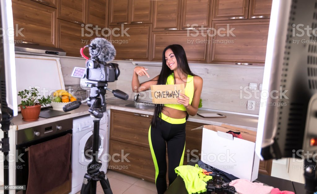 Female vlogger making video at home stock photo