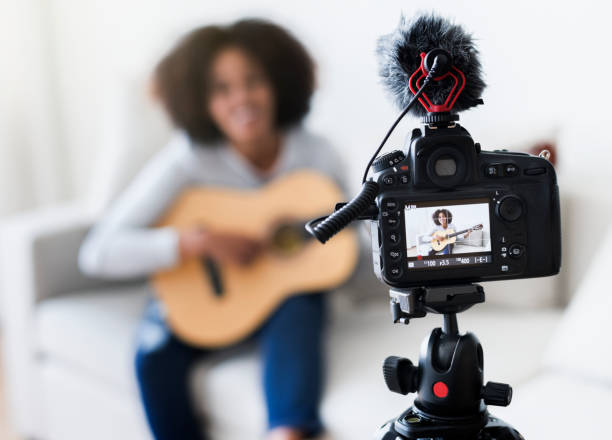 female vlogger recording music related broadcast at home - vlogger stock photos and pictures