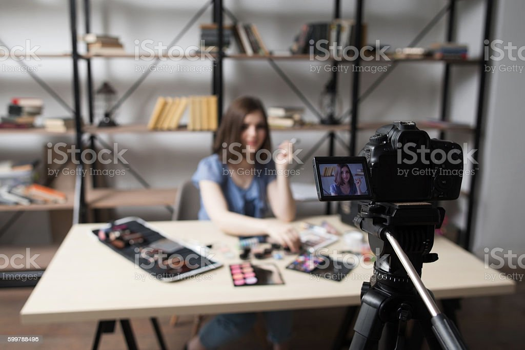 Female vlogger recording video at home stock photo