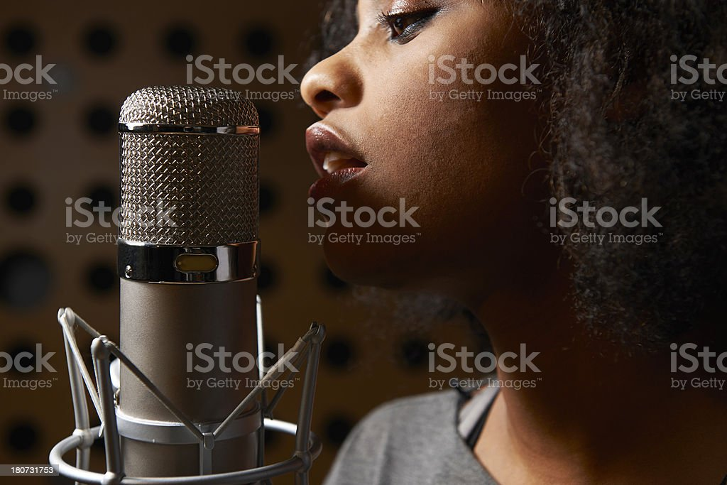Female Vocalist In Recording Studio stock photo
