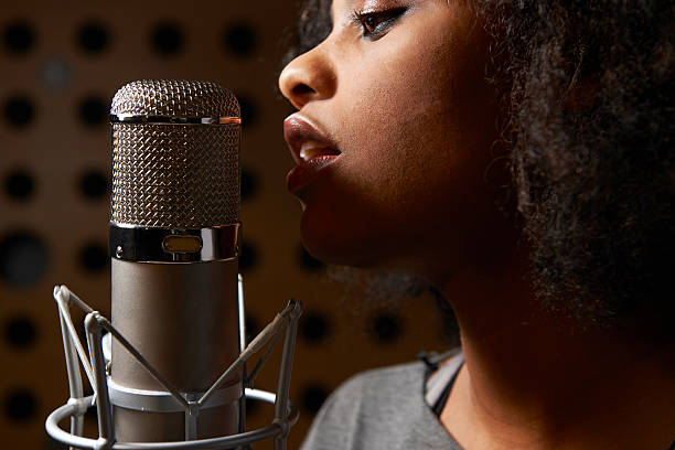 Female Vocalist In Recording Studio Laying down vocal track diva human role stock pictures, royalty-free photos & images
