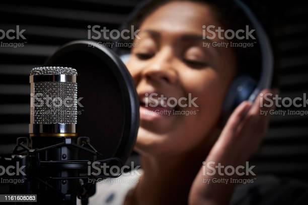 Female vocalist wearing headphones singing into microphone in studio picture id1161608083?b=1&k=6&m=1161608083&s=612x612&h=sokaqpvz7fcygwegtykust4i hcypy9y5dzm5adedc0=
