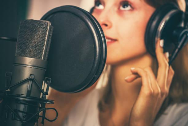 Female Voiceover Speaker in Recording Studio stock photo