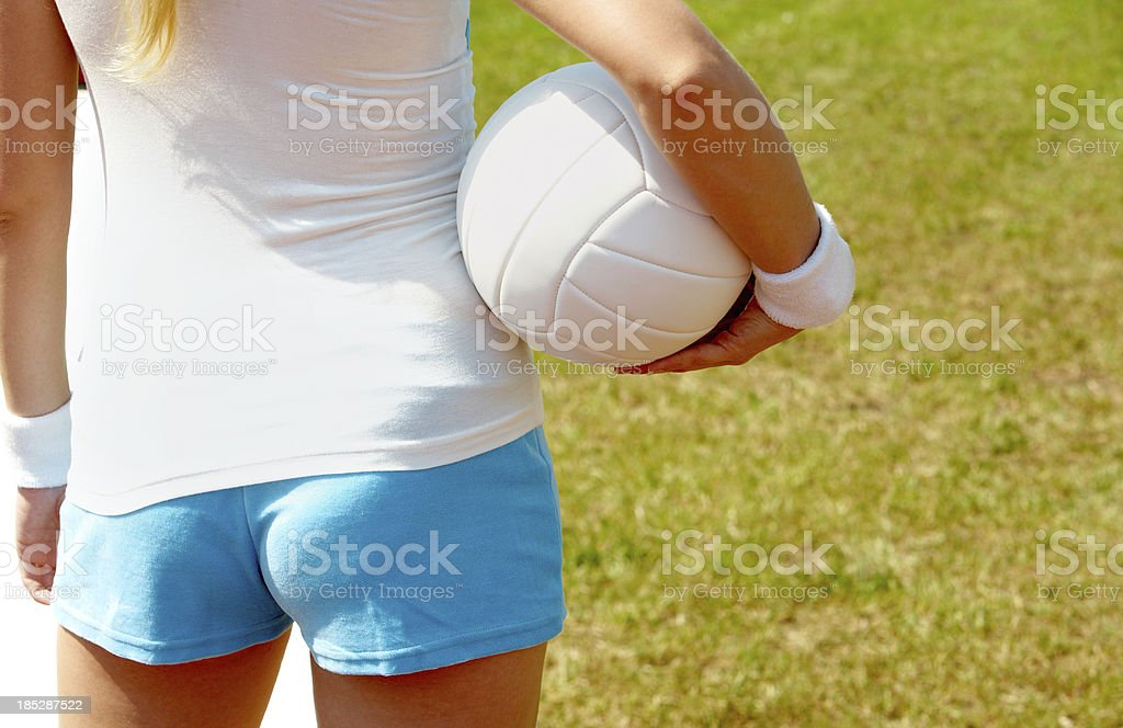 Rear view of a female with volley ball