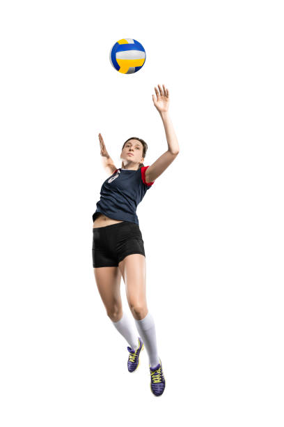 Female volleyball player hitting the ball Female volleyball player in the air before hitting the ball isolated on white background spiked stock pictures, royalty-free photos & images