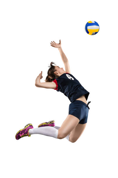 female volleyball player hitting the ball - volleyball sport stock photos and pictures