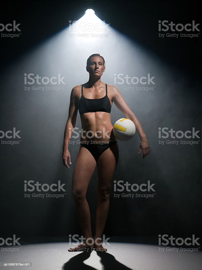 Female volleyball player holding ball, studio shot royalty-free stock photo