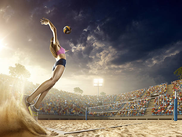 Female volleyball player in action stock photo