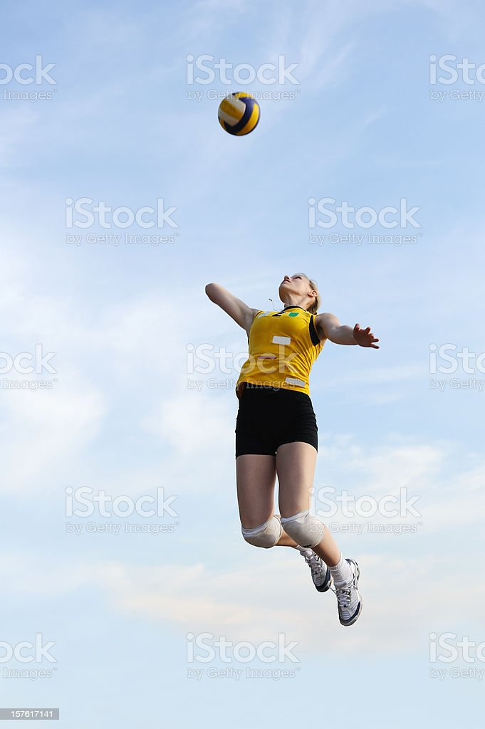 Female volleyball player serving stock photo