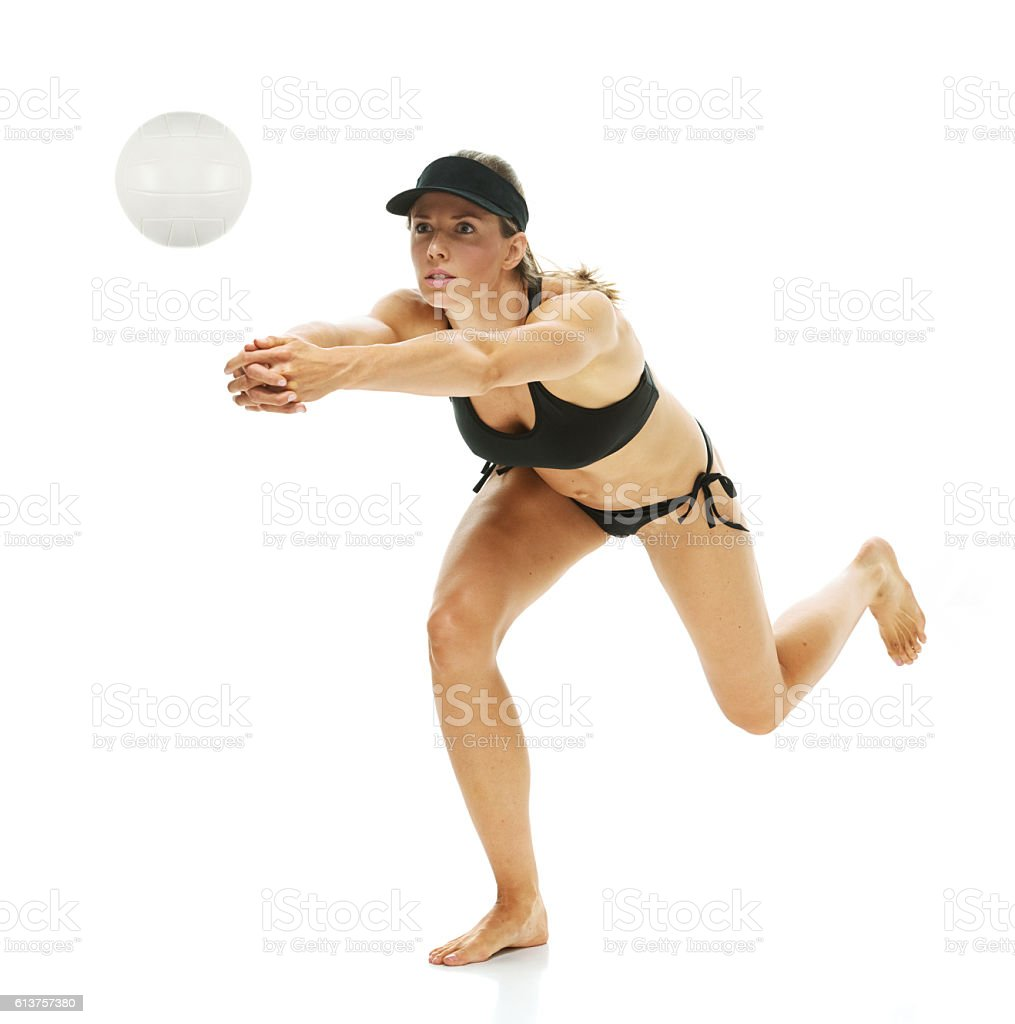 Female volleyball player volleying stock photo