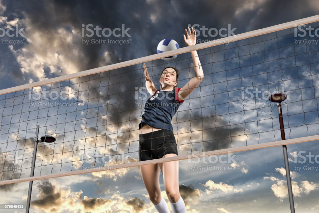 Female volleyball players jumping close-up - Photo