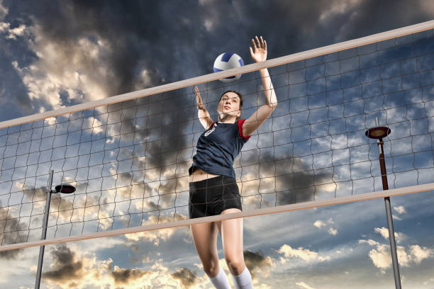 female volleyball players jumping close-up - volleyball sport stock photos and pictures