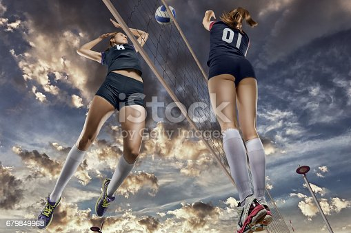 istock Female volleyball players jumping close-up 679849968