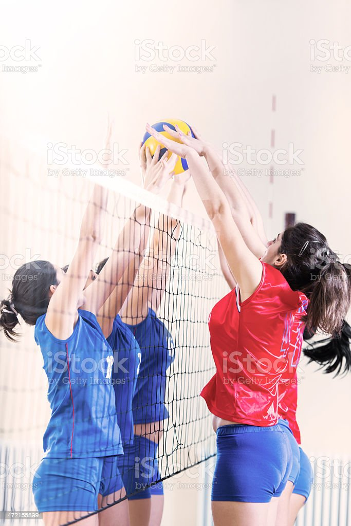 Volleyball match. Female players are on the net.