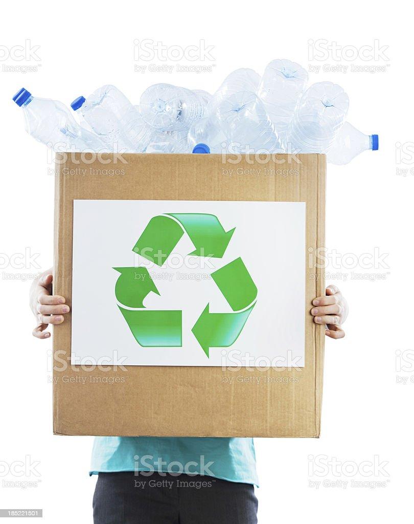 Female Volunteer holding recycling box stock photo