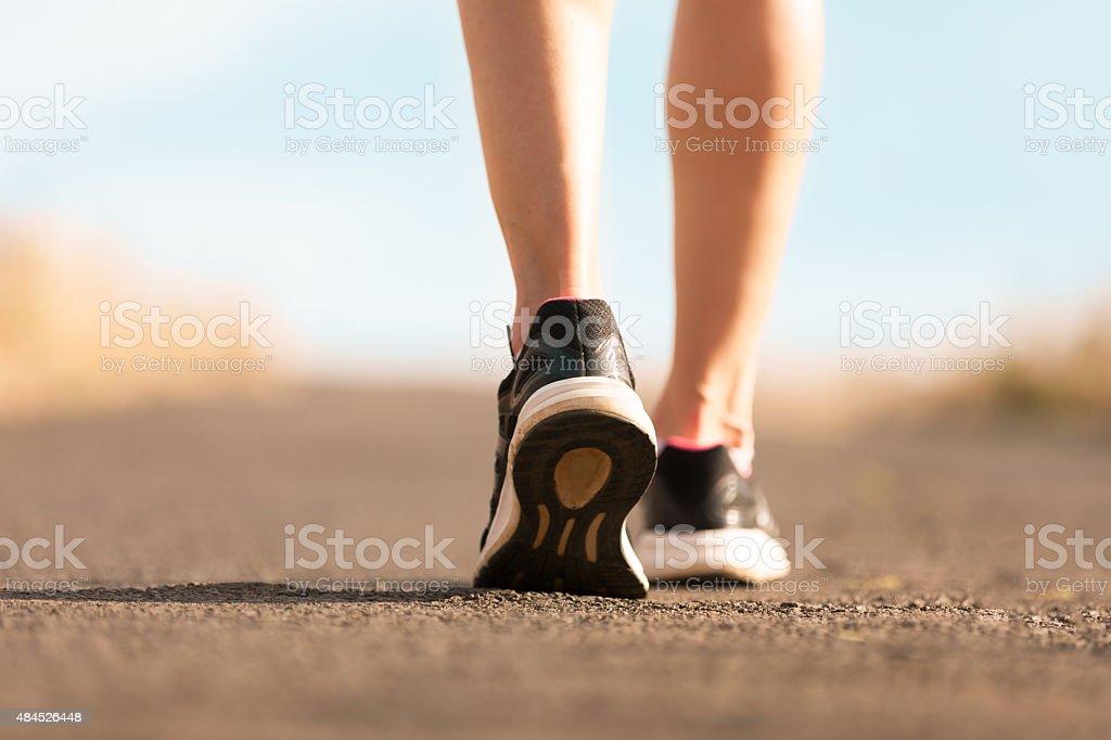 Female walking stock photo