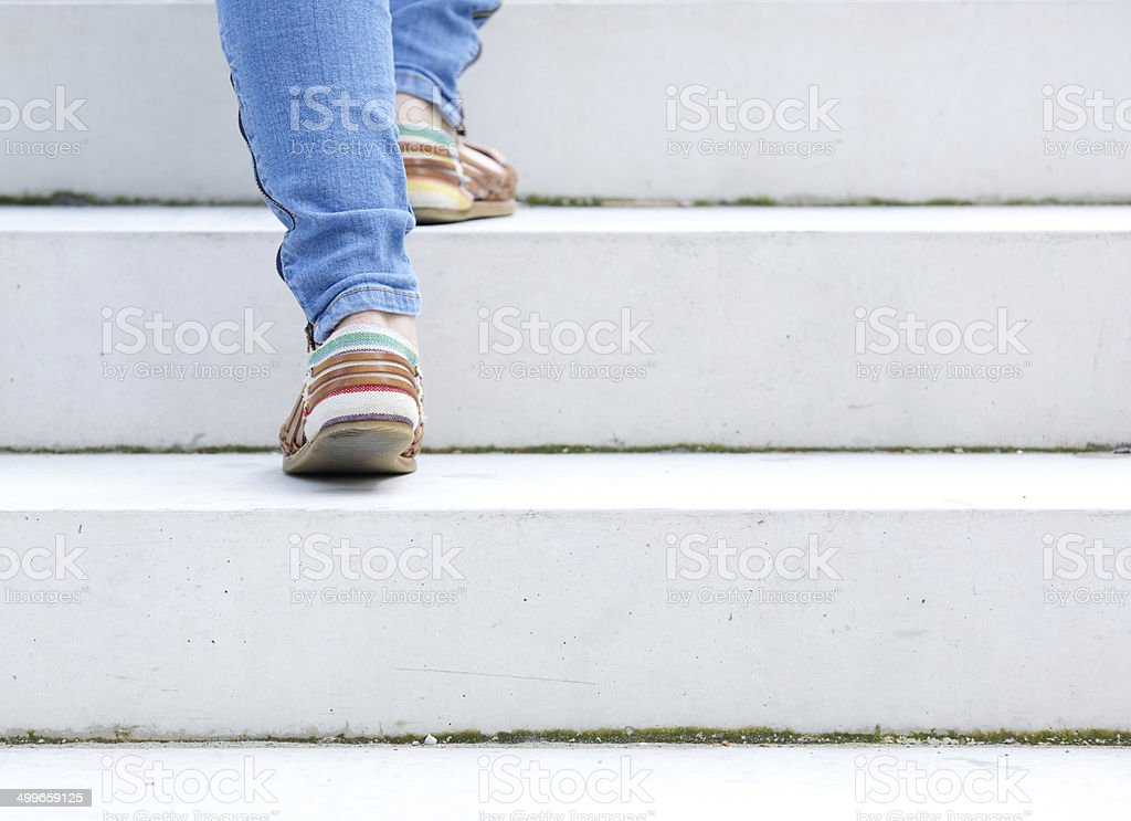 Female walking upstairs stock photo