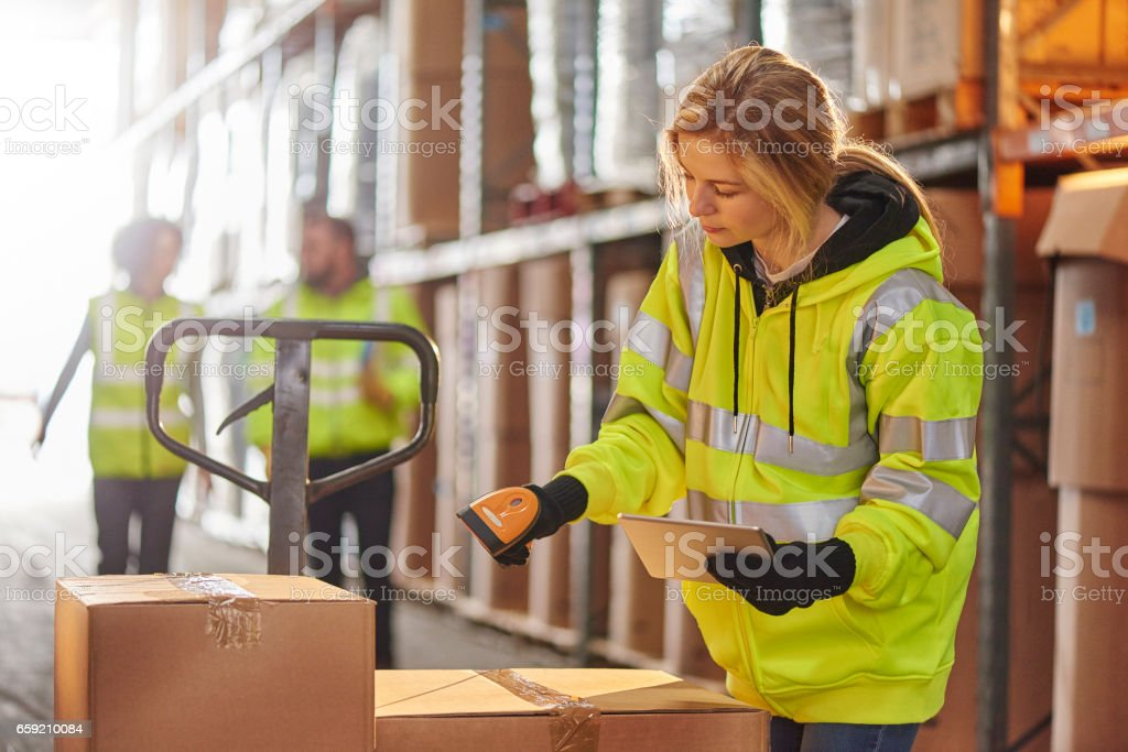 female warehouse operative stock photo