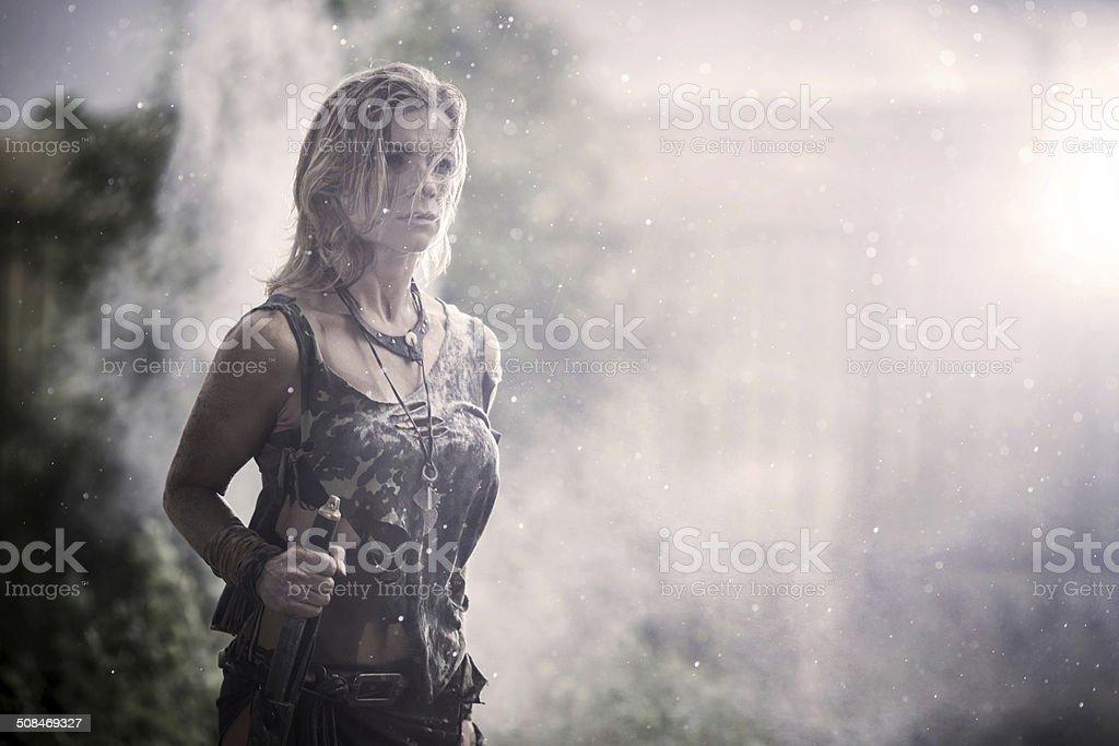 Female warrior at rain. stock photo