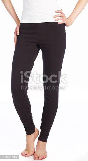 female wearing black yoga pants