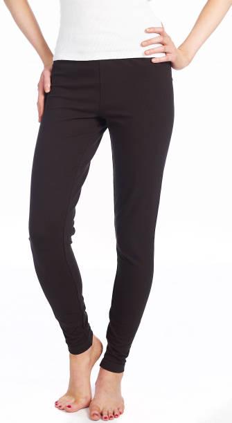 female wearing black yoga pants stock photo