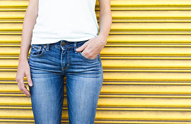 Female wearing jeans Closeup of female wearing jeans. skinny jeans stock pictures, royalty-free photos & images