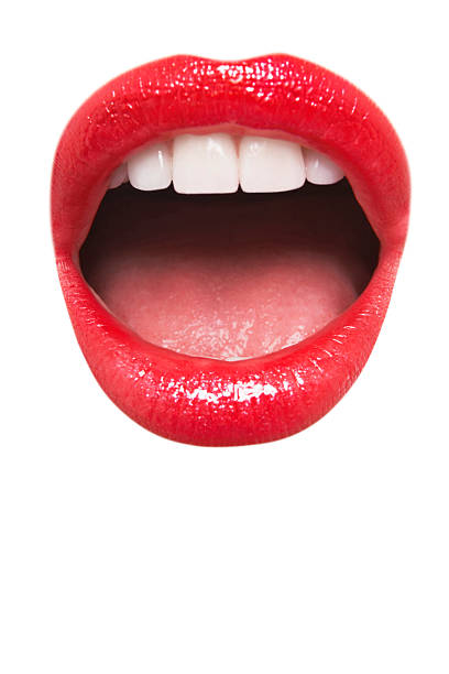 Female wearing red lipstick with mouth open Close-up view of female wearing red lipstick with mouth open over white background mouth open stock pictures, royalty-free photos & images