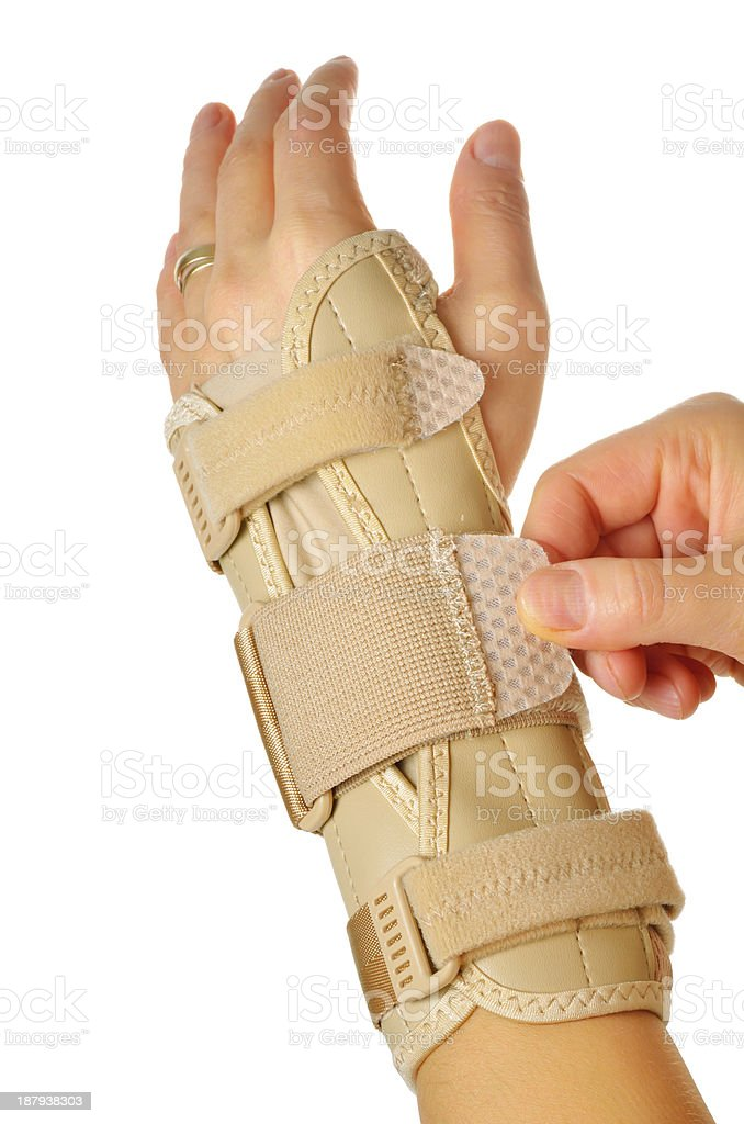 female wearing wrist brace over white background stock photo