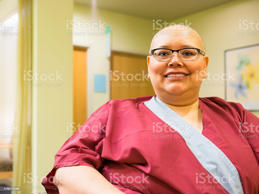 Female Wears Gown Awaiting Medical Care stock photo