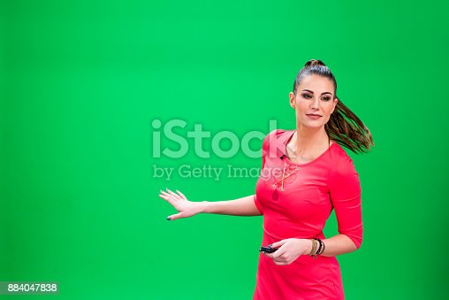 istock Female weather forcaster 884047838