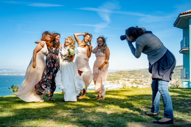 Female wedding photographer at work picture id1144489433?b=1&k=6&m=1144489433&s=612x612&w=0&h=wdwumfalyvqfksawnnnxbfmnndotrhqe3dgkrlgvqie=