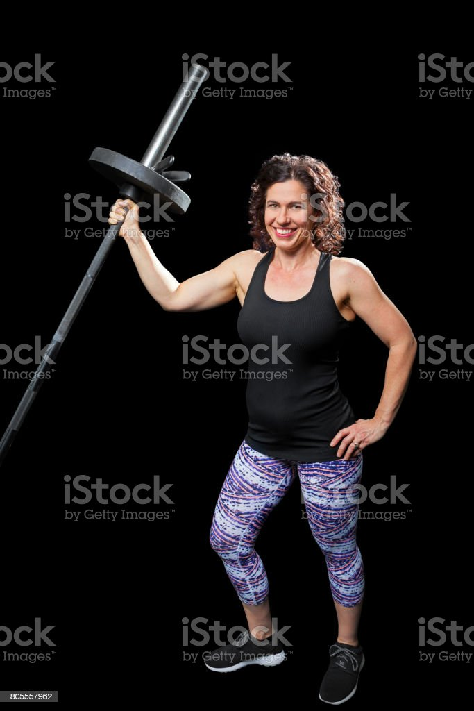 Female Weight Lifter Standing Shoulder Row stock photo