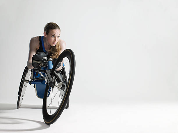 female wheelchair athlete - wheelchair sports stock photos and pictures
