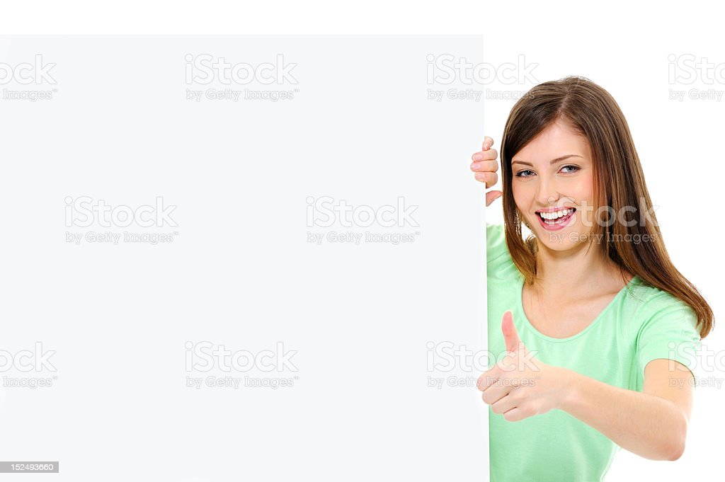 female  with a blank banner showing thumbs-up royalty-free stock photo