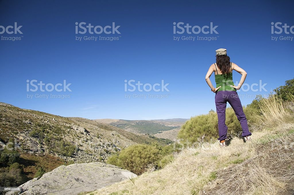 female with cap watching valley royalty-free stock photo