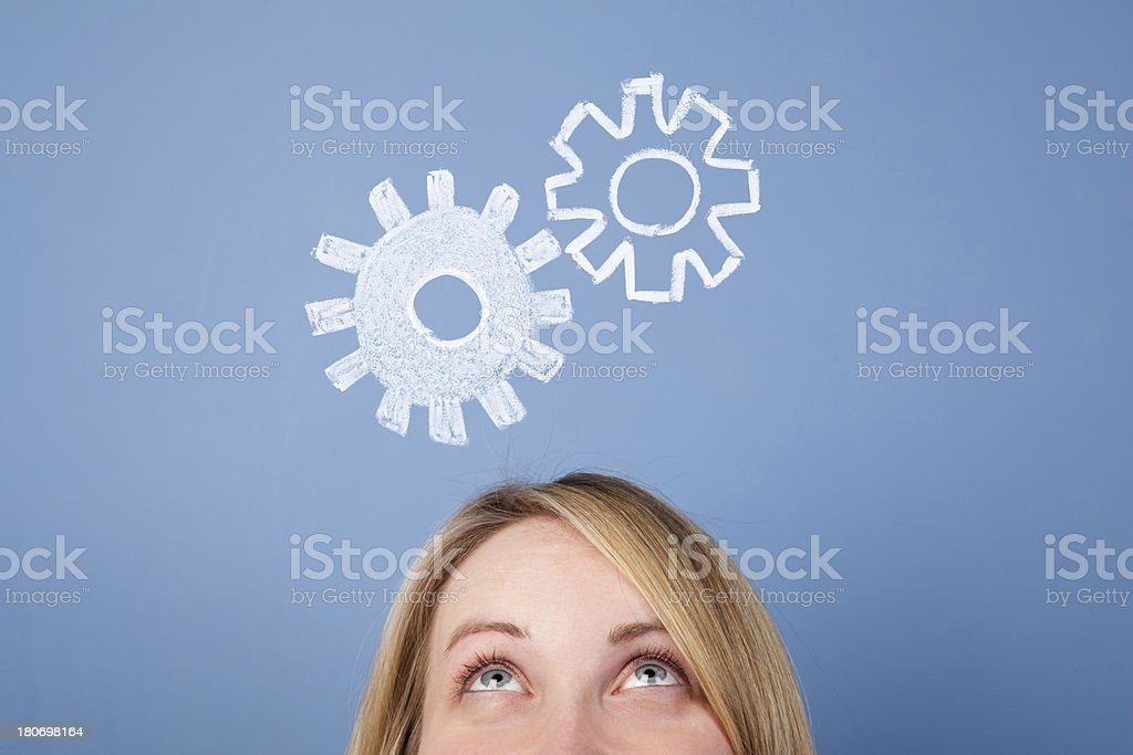 Female with cogs and gears royalty-free stock photo
