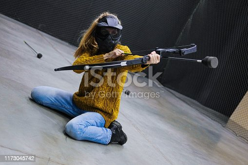 902406974 istock photo Female with crossbow arrows bow. The Archer takes aim, sharpshooter. Crossbow club. 1173045742