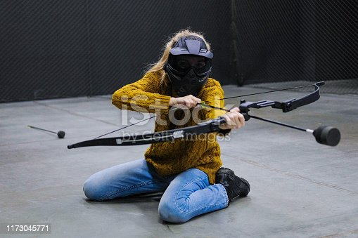 902406974 istock photo Female with crossbow arrows bow. The Archer takes aim, sharpshooter. Crossbow club. 1173045771