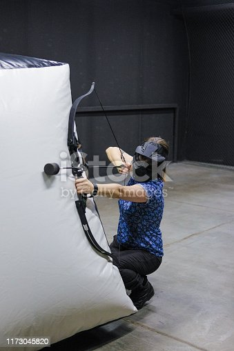 902406974 istock photo Female with crossbow arrows bow. The Archer takes aim, sharpshooter. Crossbow club. 1173045820