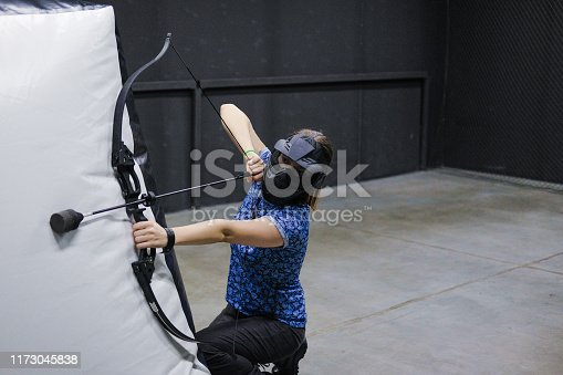 902406974 istock photo Female with crossbow arrows bow. The Archer takes aim, sharpshooter. Crossbow club. 1173045838